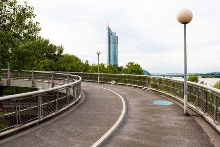 Raised spiral pedestrian and bicycle pathway next to Danube River, Vienna, Austria
