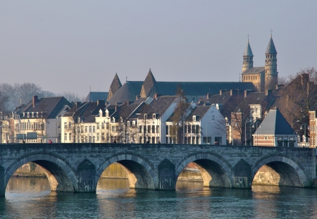 Old bridge and houses in Maastricht, Holland