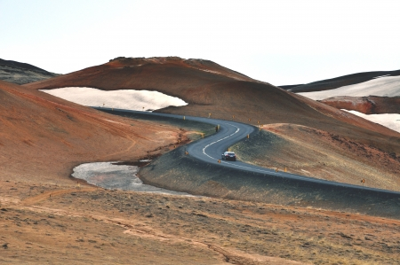 Winding mountain road in Iceland photo