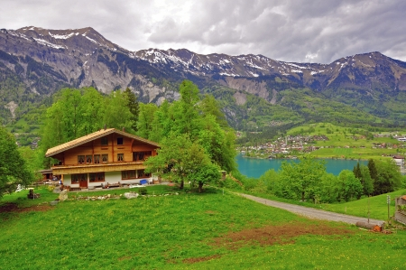 swiss alps: Swiss alps, chalet at the lake Editorial