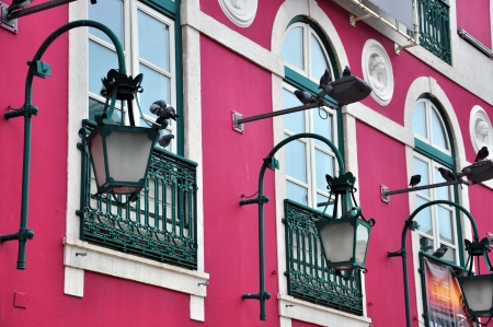 Pigeons, lights and windows in Lisbon, Portugal