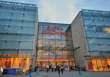 buisiness: KRAKOW, POLAND - JULY 20: People at the entrance of Galeria Krakowska on July 20, 2012. Galeria Krakowska is the biggest shopping mall of Krakow.  Editorial
