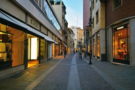 gucci store: PADOVA, ITALY - OCTOBER 3: People goes by the shopping street in Padova city centre on October 3, 2012. Padova is a city and comune in the Veneto, northern Italy.