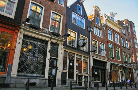 AMSTERDAM, NETHERLANDS - MARCH 25: Typical street of Amsterdam city centre on March 25, 2012. Amsterdam is a capital and the largest city of Netherlands.