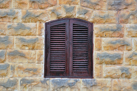 Closed windows with shutters in old house photo