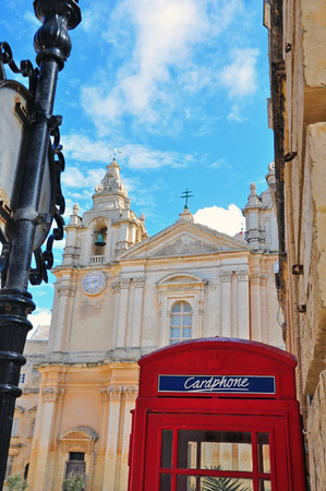Classic Telephone box and cathedral of Mdina, Malta photo