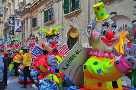 papiermache: VALLETTA, MALTA - FEBRUARY 28: Spring carnival on street of Valletta downtown on february 28, 2014. Maltese carnival holds from february 27 till march 3, 2014.