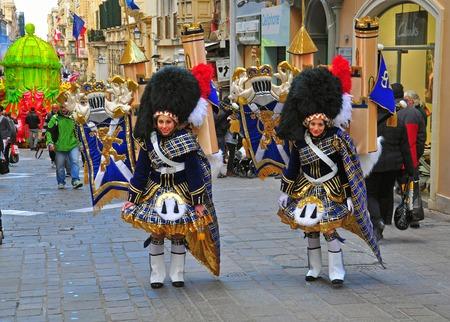 VALLETTA, MALTA - MARCH 1: Spring carnival on street of Valletta downtown on march 1, 2014. Maltese carnival holds from february 27 till march 3, 2014. Editorial