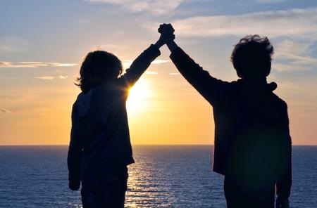 Friendship on sunset photo