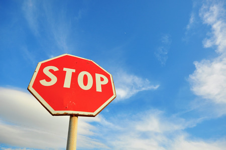 Stop sign and blue cloudy sky photo