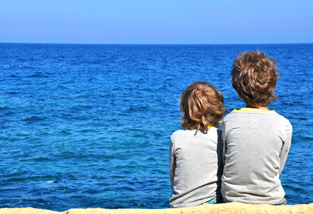 seafront: Small friends looking at horizon