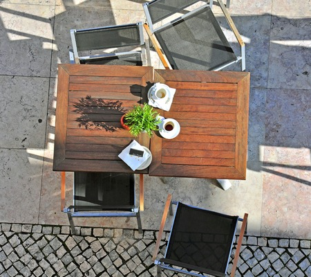 Cafe wooden table with chairs photo