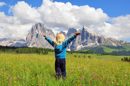 Small traveler in Dolomites, Italy