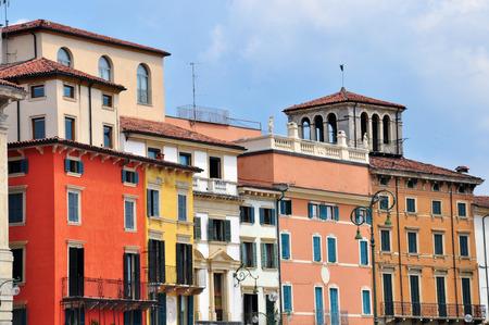 Facade of multicolor houses in Verona, Italy photo
