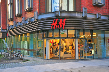 flagship: POZNAN, POLAND - AUGUST 2: Facade of H&M flagship store in Poznan downtown on August 2, 2014. H&M is a Swedish multinational clothing company, known for its fast-fashion clothing. Editorial