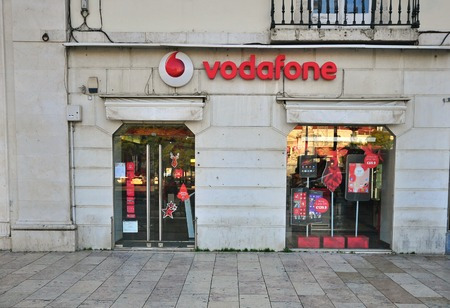 headquartered: LISBON, PORTUGAL - DECEMBER 21: Vodafone store in the street of Lisbon on December 21, 2012. Vodafone is a British multinational telecommunications company headquartered in London.