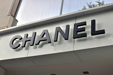 haute couture: MOSCOW, RUSSIA - AUGUST 30: Logo of Chanel store in Moscow on August 30, 2014. Chanel is a high fashion house that specializes in haute couture and ready-to-wear clothes. Editorial