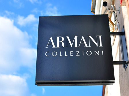 flagship: MINSK, BELARUS - OCTOBER 4: Armani Collezioni logo on the flagship store in Minsk on October 4, 2014. Armani Collezioni is a global world famous fashion brand founded in Italy. Editorial