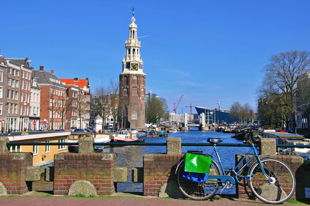 AMSTERDAM, NETHERLANDS - MARCH 27: View of a channel in Amsterdam city center on March 27, 2012. Amsterdam is the capital and most populous city of the Netherlands.
