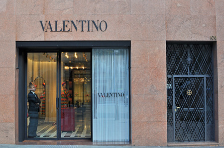 flagship: BARCELONA, SPAIN - DECEMBER 8: Facade of Valentino flagship store in the street of Barcelona on December 8, 2014. Valentino is a world famous fashion brand founded in Italy.