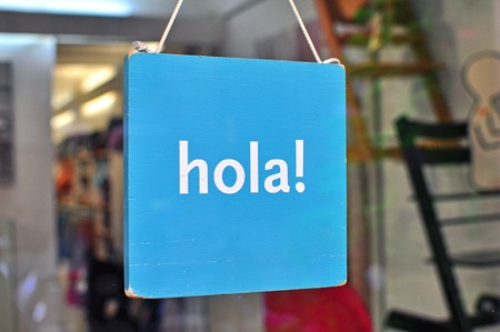 Hi hanging sign in spanish language