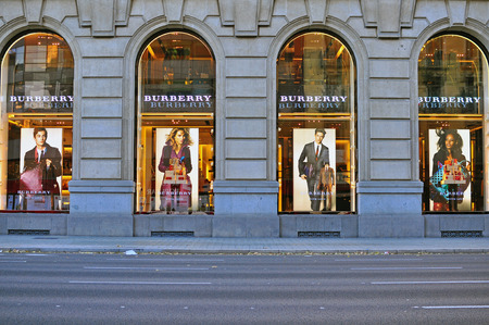 flagship: BARCELONA, SPAIN - DECEMBER 9: Facade of Burberry flagship store in the street of Barcelona on December 9, 2014. Burberry is a luxurious clothing brand based in Great Britian.