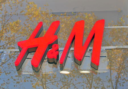 hm: BARCELONA, SPAIN - DECEMBER 9: Logo of H&M flagship store in the street of Barcelona on December 9, 2014. H&M is a world famous fashion brand founded in Sweden.