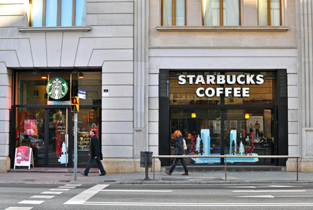 BARCELONA, SPAIN - DECEMBER 30: Starbucks coffeeshop on the street of Barcelona on December 30, 2014. Starbucks is the largest coffeehouse chain in the world.