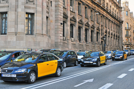 BARCELONA, SPAIN - JANUARY 1: Taxi cars on the street of Barcelona downtown on January 1, 2015. Barcelona is the second largest city of Spain.