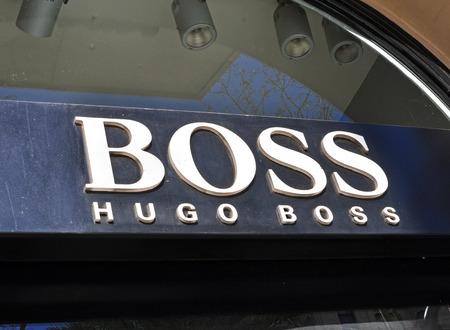 hugo: BARCELONA, SPAIN - FEBRUARY 1: Logo of Hugo Boss flagship store in the street of Barcelona on February 1, 2014. Hugo Boss is a world famous sport brand. Editorial