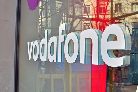 BARCELONA, SPAIN - FEBRUARY 5: Logo of Vodafone company in the shop on February 5, 2015. Vodafone is a British multinational telecommunications company.