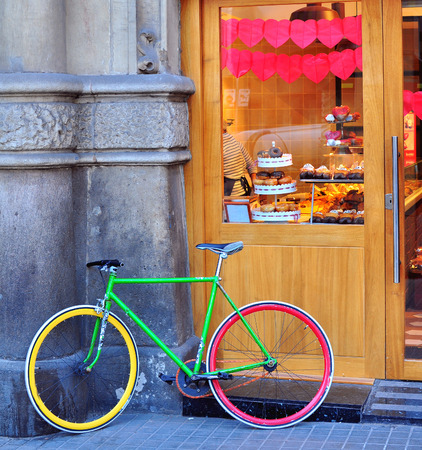 bike: Colorful bike at the bakery on the street of Barcelona Stock Photo