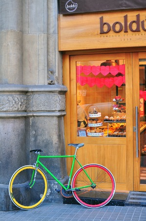 BARCELONA, SPAIN - FEBRUARY 7: Colorful bakery showcase with a bike on the street of Barcelona on February 7, 2015. Barcelona is the second largest city of Spain.