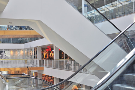 VILNIUS, LITHUANIA - APRIL 12: Escalators and shopping gallery of Prekybos centras GO9 mall in Vilnius downtown on April 12, 2015. Vilnius is the capital and largest city of Lithuania.