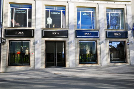retailer: VILNIUS, LITHUANIA - APRIL 12: Facade of Hugo Boss flagship store in Vilnius downtown on April 12, 2015. Hugo Boss is a world famous retailer founded in Germany.