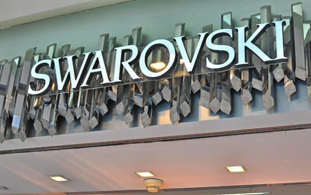 swarovski: HO CHI MINH, VIETNAM - MARCH 6: Logo of Swarovski flagship store in Ho Chi Minh city centre on March 6, 2015. Swarovski is an austrian producer of luxury cut lead glass.