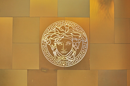 HO CHI MINH, VIETNAM - MARCH 7: Logo of Versace flagship store in Ho Chi Minh city centre on March 7, 2015. Versace is a world famous fashion brand founded in Italy.