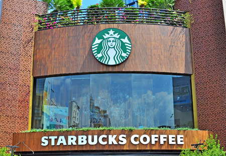 HO CHI MINH, VIETNAM - MARCH 6: Starbucks coffeeshop in Ho Chi Minh city centre on March 6, 2015. Ho Chi Minh is the secord largest city of Vietnam.