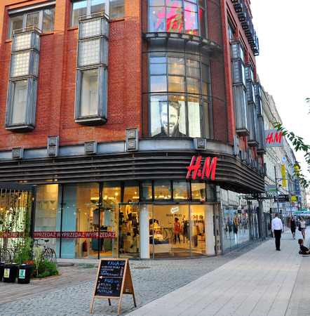 buisiness: POZNAN, POLAND - AUGUST 2: Facade of H&M flagship store in Poznan downtown on August 2, 2014. H&M is a Swedish multinational clothing company, known for its fast-fashion clothing. Editorial