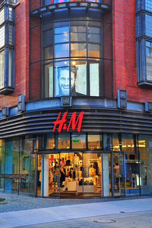 hm: POZNAN, POLAND - AUGUST 2: Facade of H&M flagship store in Poznan downtown on August 2, 2014. H&M is a Swedish multinational clothing company, known for its fast-fashion clothing. Editorial