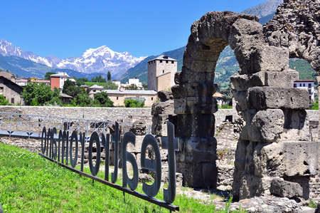 aosta: AOSTA, ITALY - JUNE 28: View of the roman ruins in Aosta on June 28, 2015. Aosta is the capital and largest city of Val dAosta region, Italy.