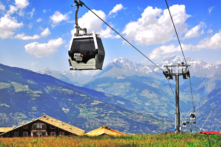 pila: AOSTA, ITALY - JULY 4: Cable car in Pila mountain near Aosta on July 6, 2015. Aosta is the capital and largest town of Val dAosta, Italy. Editorial