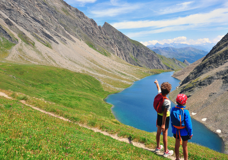 val: Two kids in mountains, Val dAosta, Italy Stock Photo