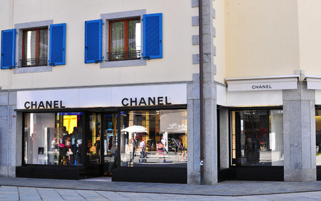 chanel: CHAMONIX, FRANCE - JULY 31: Facade of Chanel flagship store in Chamonix old town on July 31, 2015. Chanel is a world famous luxury fashion couture.