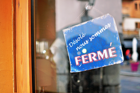 closed sign: Closed sign in french language Stock Photo