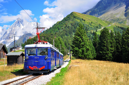 tramway: SAINT GERVAIS, FRANCE - AUGUST 20: Old fashioned Montblanc tramway goes through the Chamonix valley on August 20, 2015. The Mont Blanc Tramway is a mountain railway line in the Haute-Savoie department of France. Editorial