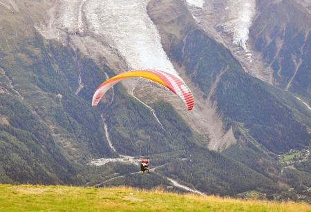 paraglider: Paraglider in mountains
