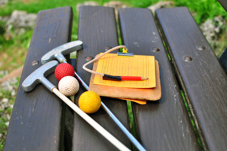Mini golf equipment on the bench