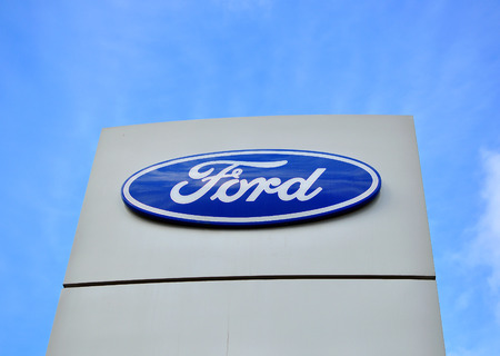 automaker: MOSCOW, RUSSIA - OCTOBER 10, 2015: Logotype of Ford corporation on October 10, 2015. Ford is an American multinational automaker. Editorial