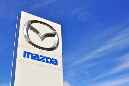 MOSCOW, RUSSIA - OCTOBER 10, 2015: Logotype of Mazda corporation on October 10, 2015. Mazda is the Japanese automotive manufacturer. Editorial